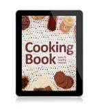 Compressa di Digital che cucina libro fotografia stock libera da diritti