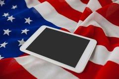 Compressa di Digital sulla bandiera americana Fotografia Stock