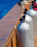 Compressed Air Tanks on Scuba Diving Boat. Three aluminum Compressed Air Tanks on Scuba Diving Boat stock photos