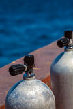 Compressed Air Tanks on Scuba Diving Boat. Two aluminum Compressed Air Tanks on Scuba Diving Boat stock photography