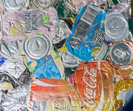 Compressed aluminium drink cans with branding showing ready for Stock Photography