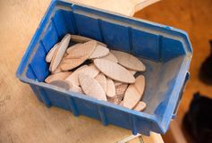 Compressed beech wood biscuit in a blue plastic container stock image