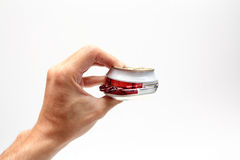 Compressed beer can in hand. Closeup for design work stock image