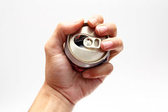Compressed beer can in hand Stock Photos