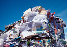 Compressed blocks of paper at recycling plant. Compressed blocks of paper and cardboard ready for recycling Royalty Free Stock Image