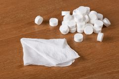 Compressed coin tissues and spreaded out tissue Stock Image