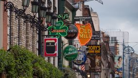 Irish pub signs outside pubs in Temple bar, Dublin, Ireland. Compressed perspective of traditional Irish pub signs outside pubs and bars in Temple bar area royalty free stock image