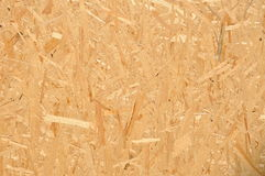 Compressed wood chippings board. Texture of compressed wood chippings board royalty free stock photos
