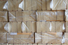 Compressed wood chips in plastic packaging Stock Photo