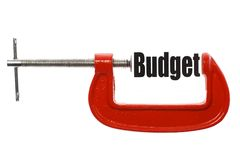 Compressing the budget. Detail of a vice compressing the word Budget. Business metaphor Royalty Free Stock Photos
