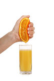 Compression orange hand Royalty Free Stock Image