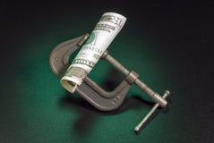 Compressione dei soldi Immagine Stock