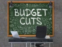Compressions budgétaires tirées par la main sur le tableau de bureau 3d Image stock