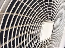 Compressor of air conditioner, the white machine that similar to the fan blades. There is a white sieve covered. And there is a little bit dirty dust royalty free stock photos