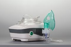Compressor inhaler for physiotherapy, on gray. Background Royalty Free Stock Photo