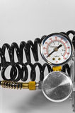 Compressor pressure gauge with black pipes. Royalty Free Stock Photo