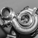 Compressor for turbo car internal combustion engine. New turbocharger compressor isolated on gray background stock photos