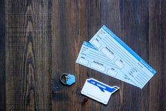 Compri i biglietti per il viaggio Biglietti sul copyspace di legno di vista superiore del fondo della tavola Fotografia Stock Libera da Diritti
