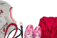 Compri le donne alla moda scarpe da tennis e magliette felpate del ` s fotografia stock