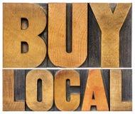 Compri le parole locali nel tipo di legno Fotografie Stock Libere da Diritti