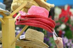 Compri un cappello Fotografia Stock