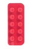 Comprimé dans le habillage transparent rouge Photos libres de droits