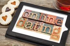 Comprimé en ligne de datingon Photo libre de droits