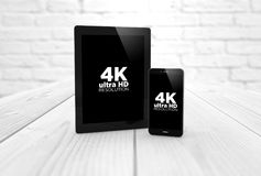 comprimé 4k et téléphone intelligent Photo stock