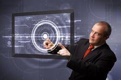 Comprimé moderne émouvant de technologie d'homme d'affaires Photographie stock libre de droits