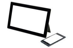 Comprimé noir moderne avec le téléphone portable d'isolement Images stock