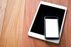 Comprimés de Digital et téléphone intelligent photos stock