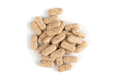 Comprimés de vitamines multi sur le blanc Photographie stock