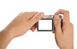 Comprima a câmera digital da foto realizada nas mãos Imagem de Stock Royalty Free