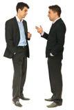 Comprimento cheio da conversação dos homens de negócio Foto de Stock