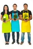 Comprimento cheio da equipe de três floristas Fotos de Stock Royalty Free