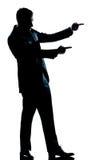 Comprimento cheio do homem da silhueta que mostra apontar Imagem de Stock