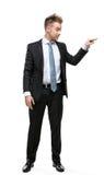 Comprimento completo do ajuste do homem de negócios contra algo Fotografia de Stock Royalty Free