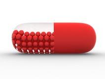 Comprimido médico vermelho 3D. Vitaminas Fotografia de Stock