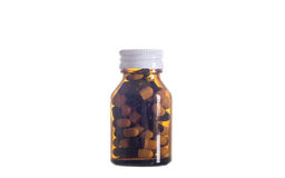 Comprimido na garrafa de vidro Imagens de Stock