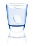 Comprimido na água Fotografia de Stock