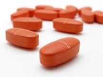 Comprimidos alaranjados Imagens de Stock