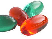 Comprimidos alaranjados e verdes Imagem de Stock Royalty Free