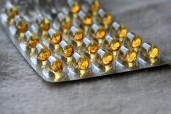 Comprimidos amarelos brilhantes Fotografia de Stock Royalty Free