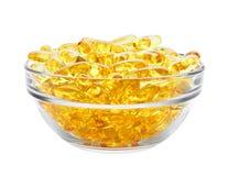 Comprimidos amarelos na bacia Fotografia de Stock
