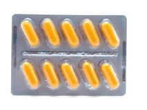 Comprimidos amarelos no bloco de bolha Foto de Stock