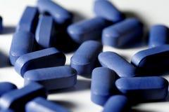 Comprimidos azuis Fotografia de Stock Royalty Free