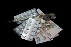 Comprimidos brancos, tabuletas, cápsulas Termômetro, que mostra um tempe Imagens de Stock