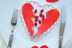 Comprimidos contra o amor e coração quebrado Imagens de Stock