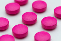 Comprimidos cor-de-rosa fotografia de stock royalty free