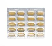 Comprimidos de Brown em um bloco de bolha fotos de stock royalty free